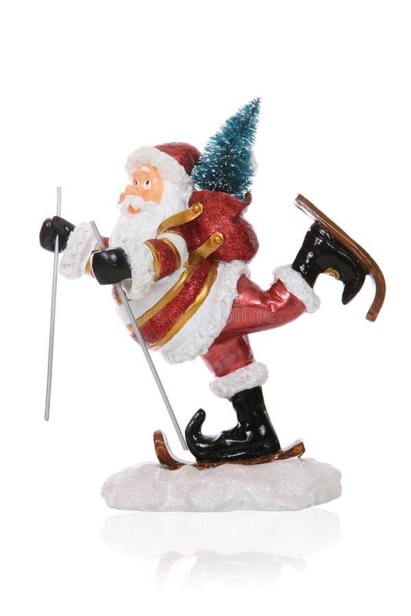 Weihnachtsmann-Skifahren stockbild
