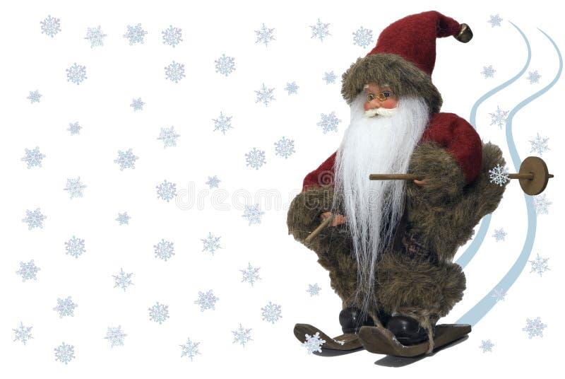 Weihnachtsmann-Skifahren mit Schnee stockfotografie