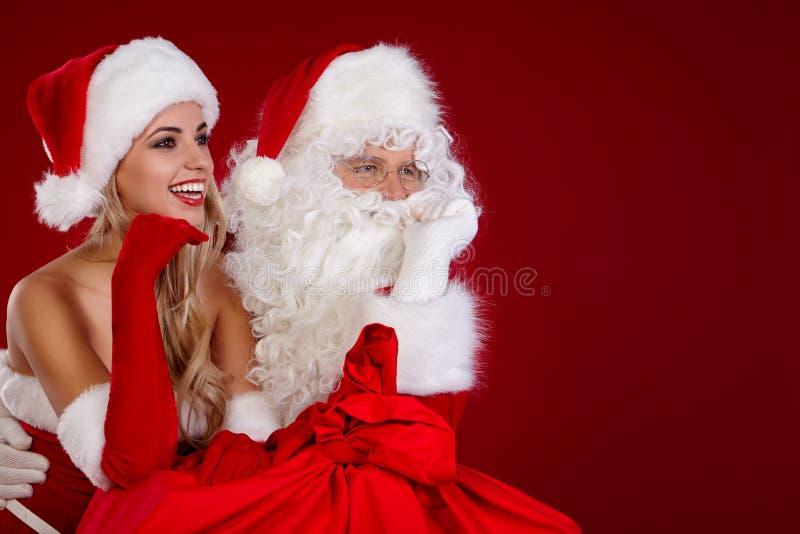 Weihnachtsmann und erstaunliches Weihnachtsmädchen lizenzfreies stockfoto