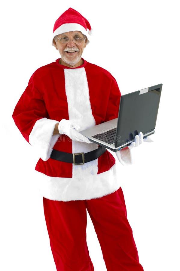 Weihnachtsmann und Laptop stockfotos