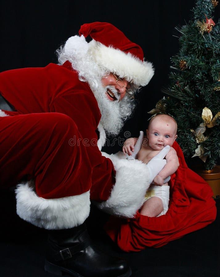 Weihnachtsmann und Schätzchen stockfotos