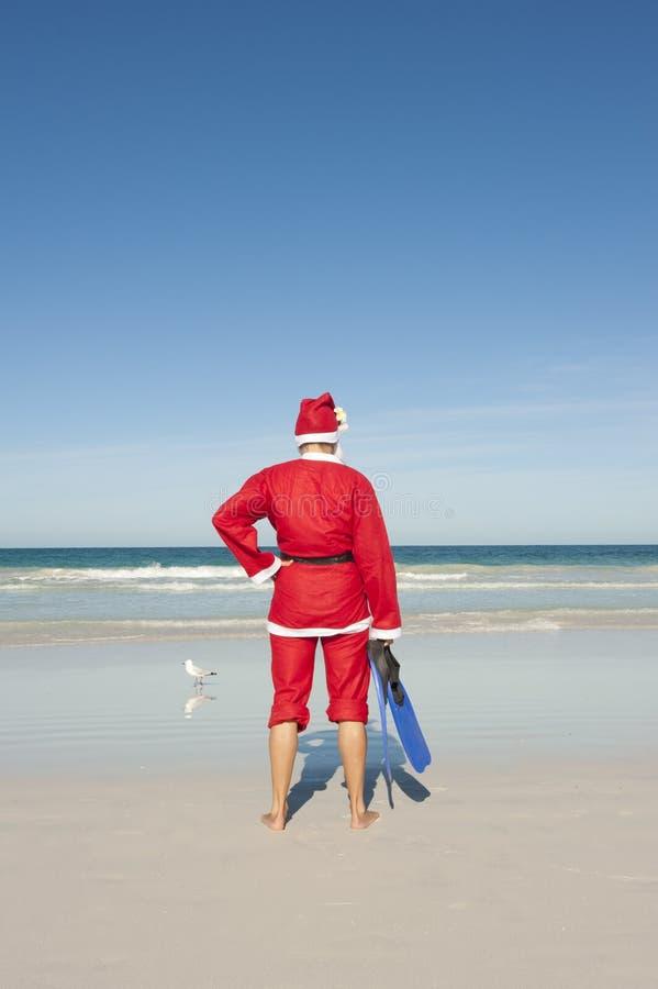 Weihnachtsmann-Weihnachtsstrand-Ferien stockfotografie