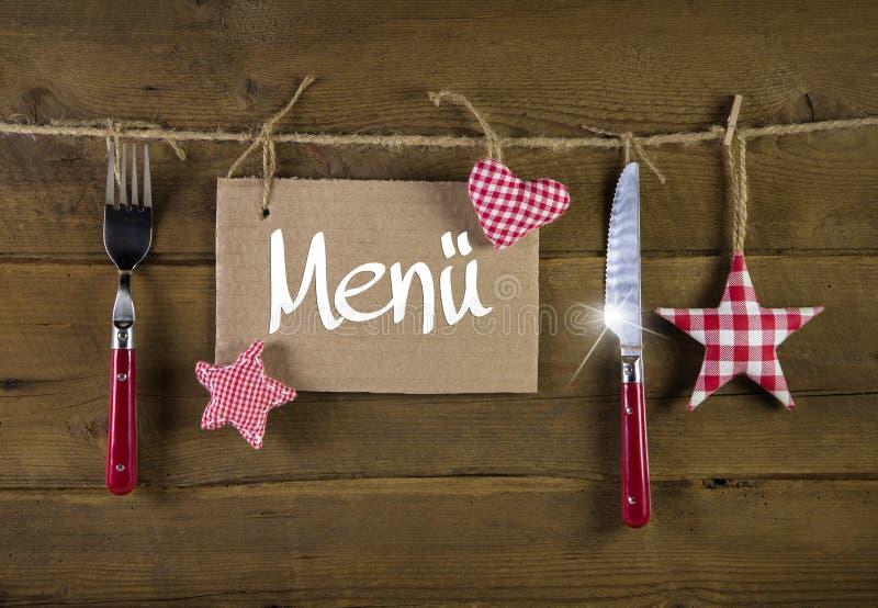 Weihnachtsmenükarte für Restaurants mit Messer und Gabel auf woode lizenzfreies stockbild