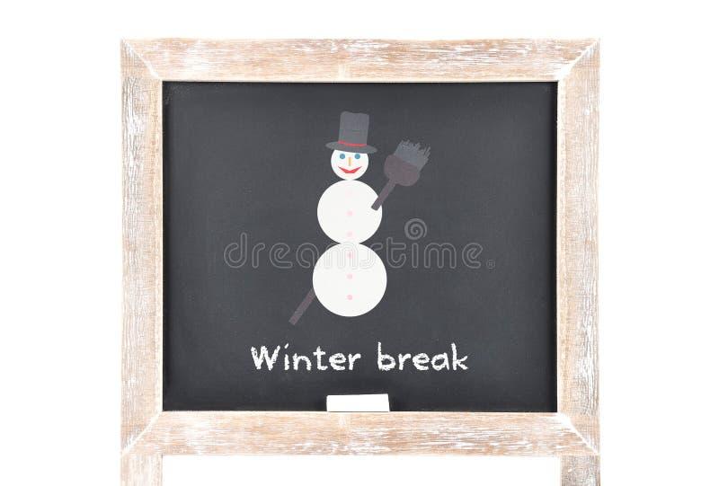 Weihnachtspause mit Schneemann auf Tafel stockbilder