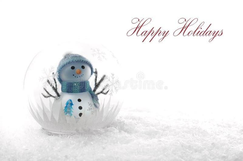 Weihnachtsschneemann in einer Kugel lizenzfreies stockfoto