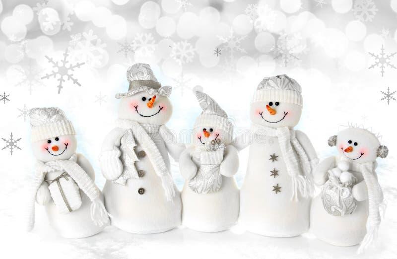 WeihnachtsSchneemannfamilie lizenzfreies stockfoto
