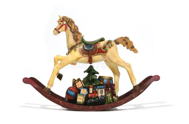 Weihnachtsschwingpferd stockfotos