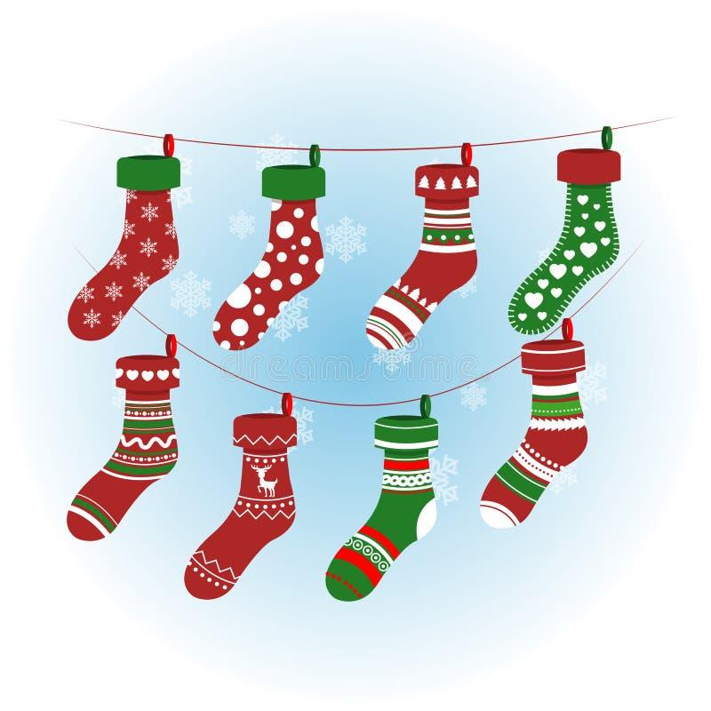 Weihnachtssocken in der roten Farbe Bunte Strümpfe des Vektors Weihnachtsmit verschiedenen Mustern lizenzfreie abbildung