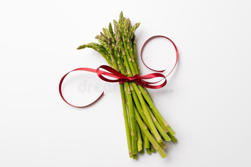 Weihnachtsspargel mit Bogen lizenzfreies stockbild