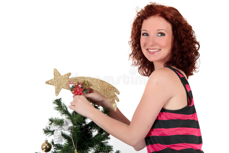 Weihnachtsstern. Attraktive junge Frau lizenzfreie stockfotos