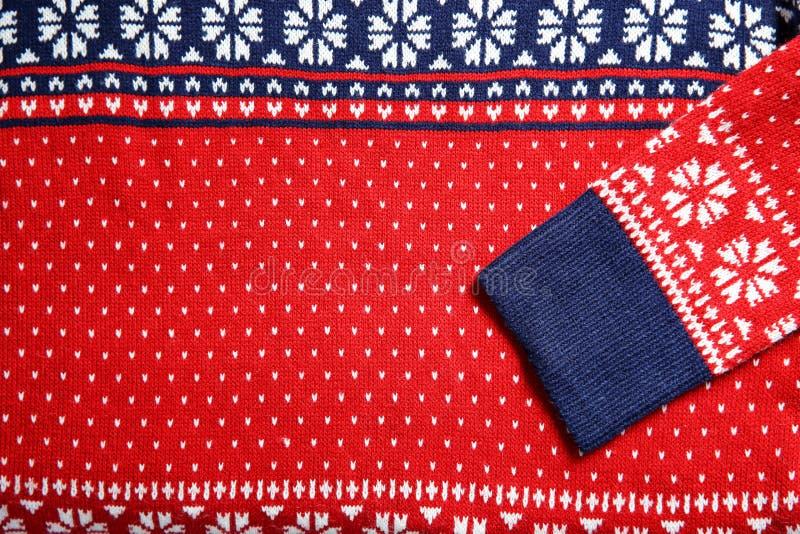 Weihnachtsstrickjacke mit Muster als Hintergrund stockbilder