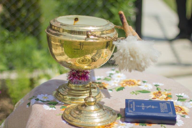 Weihwasser und Gebet stockbilder