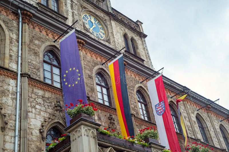 Weimar town hall building flags display unesco Thuringia Germany stock photos