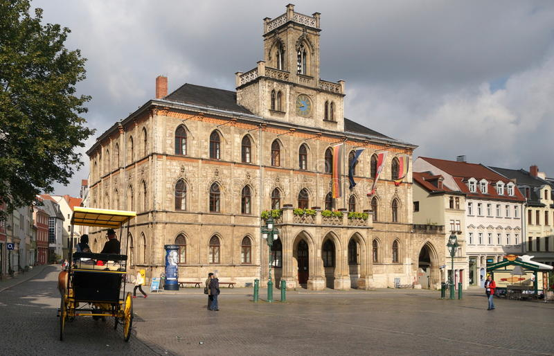 Weimar Town Hall. The Neo-Gothic town hall of Weimar was re-built in 1841 after destruction by fire. The city of Weimar in the federal state of Thuringia stock photos
