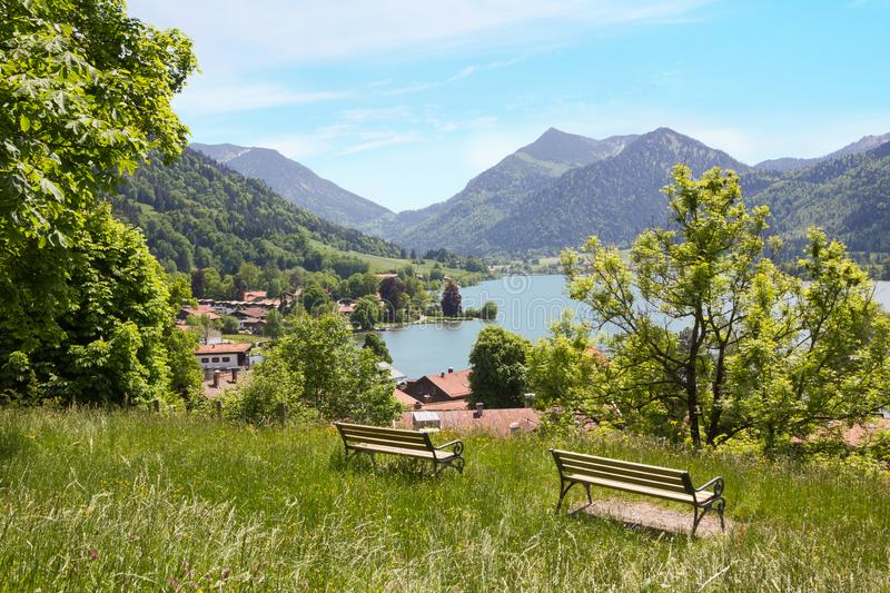 Weinberg hill with benches, lookout point at health resort schliersee. Idyllic weinberg hill with benches, lookout point at health resort schliersee. beautiful stock photography