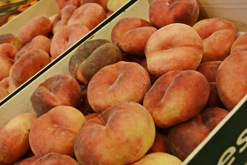 Weinberg Pfirsich peach. Weinbergpfirsch or Weinberg peach is a peach that is a little bit flatten stock images