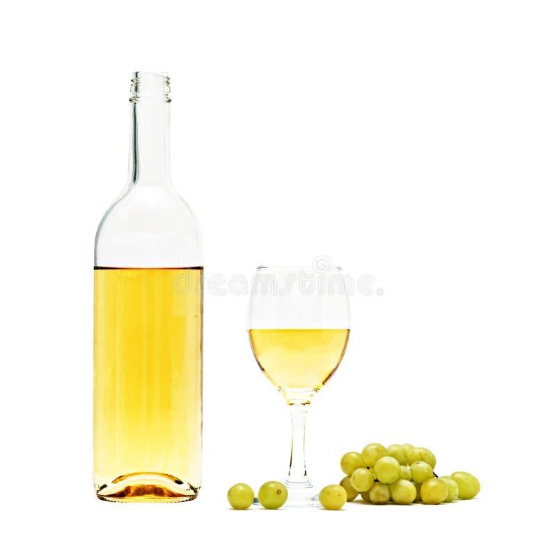Weinflasche, Becher und Trauben lizenzfreie stockfotografie