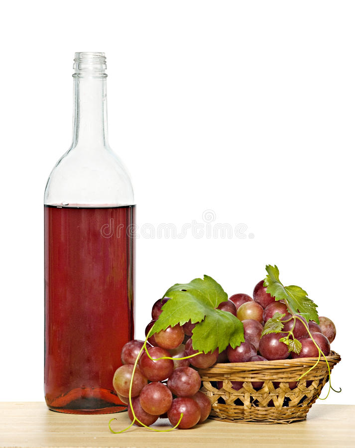 Weinflasche und Weinstock stockfotos