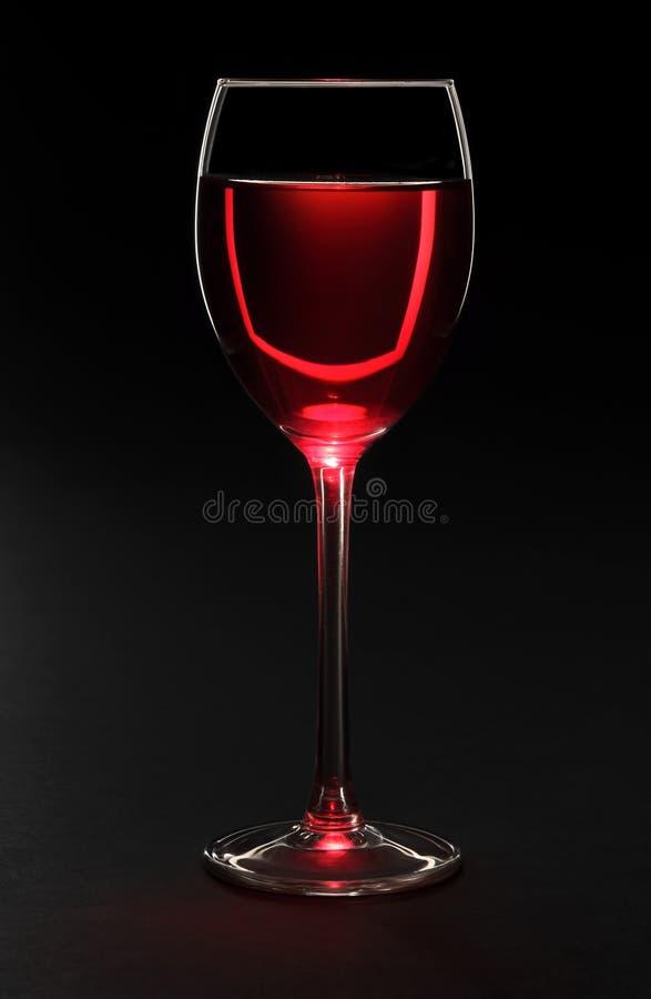 Weinglas auf Schwarzem stockbilder
