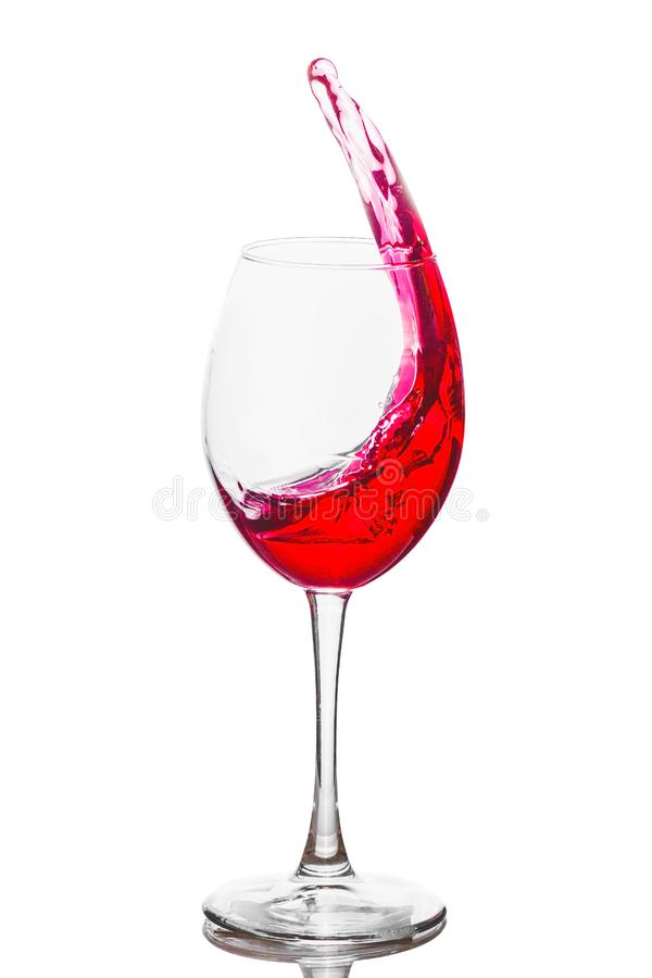 Weinglas mit Innere des rosafarbenen Weins, Weinwelle, heller Hintergrund lizenzfreies stockfoto