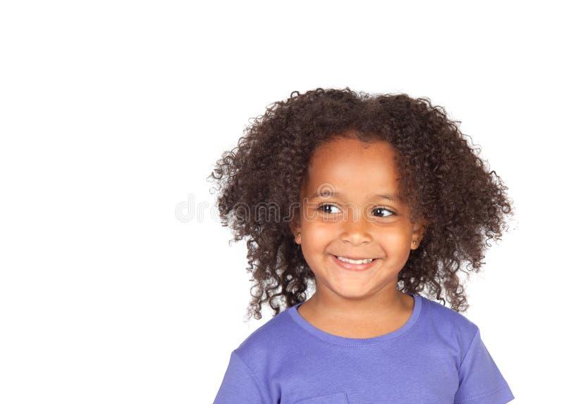 Weinig Afrikaans meisje met een mooie uitdrukking stock fotografie