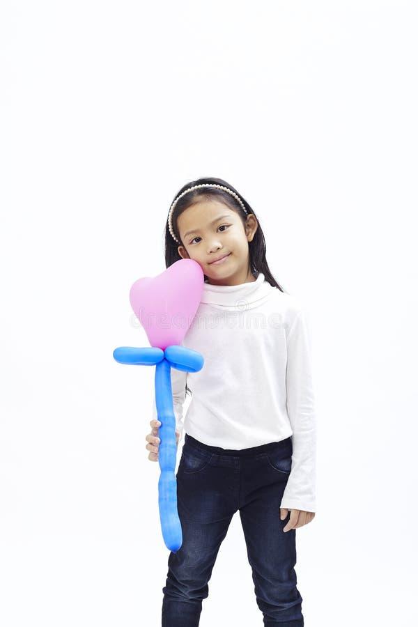 Download Weinig Aziatisch Meisje Met Roze Ballon Stock Afbeelding - Afbeelding bestaande uit mooi, manier: 107707861