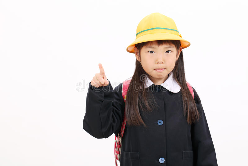 Weinig Aziatisch schoolmeisje stock fotografie