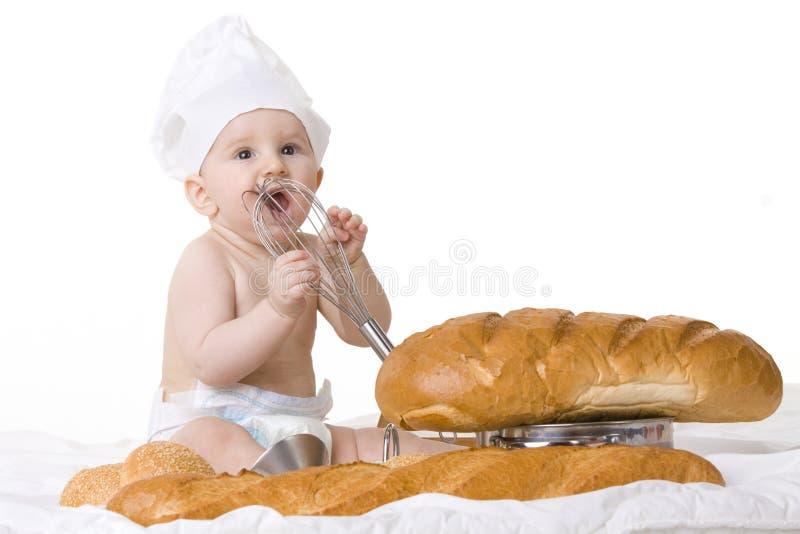 Weinig babychef-kok stock foto's