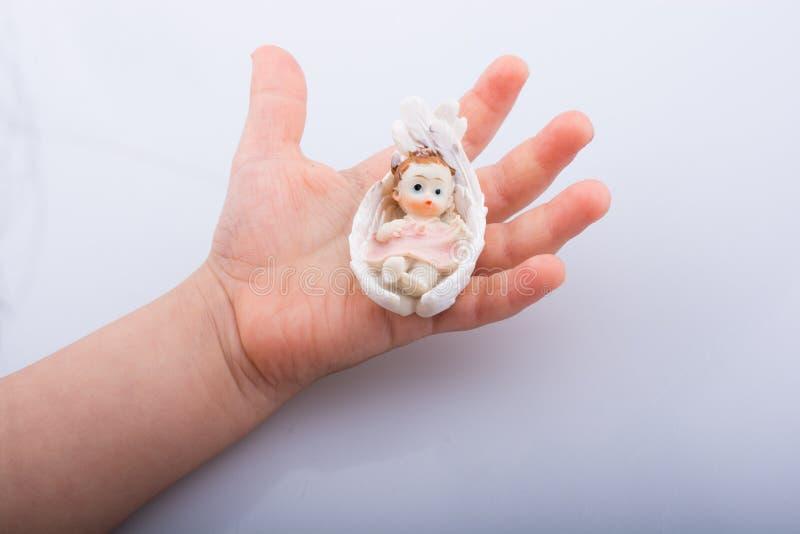 Weinig babycijfer ter beschikking stock fotografie