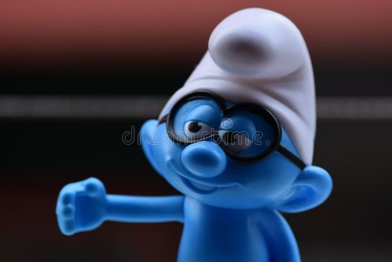 Weinig Blauwe Smurfs, Glazen Smurf stock foto's