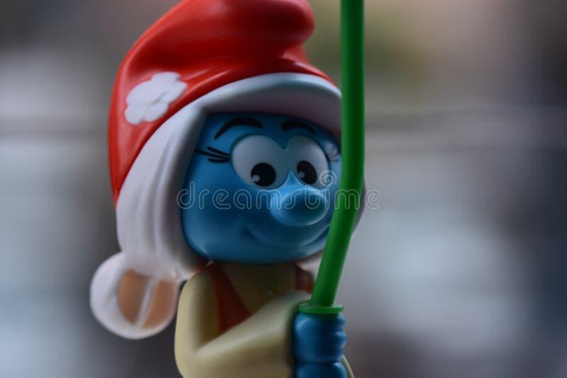 Weinig Blauwe Smurfs, Misser Smurf stock fotografie