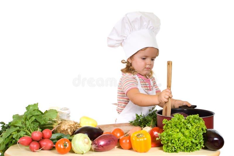 Weinig chef-kok die gezonde maaltijd prepating stock afbeeldingen