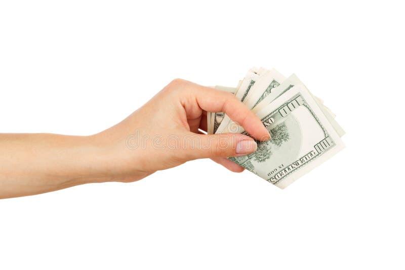 Weinig dollars in de geïsoleerde vrouwen` s hand, stock afbeeldingen