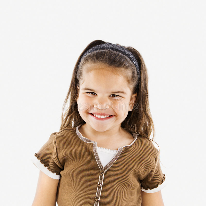 Weinig glimlachend Spaans meisje. stock fotografie