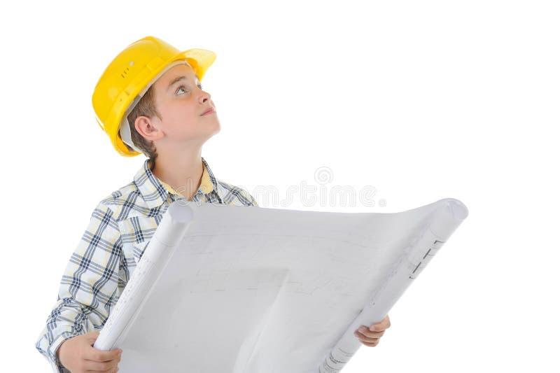 Weinig glimlachende bouwer in helm stock foto