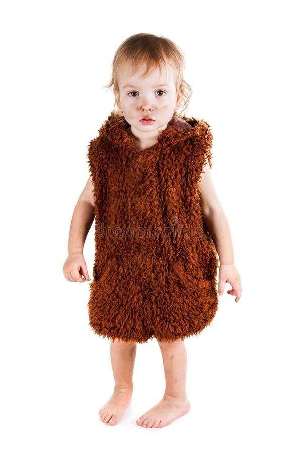 Weinig grappige Neanderthaler jongen in een kostuum met smerig gezicht royalty-vrije stock foto's