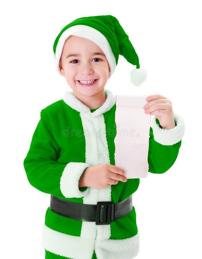 Weinig groene Santa Claus-jongen die wenslijst tonen stock afbeelding