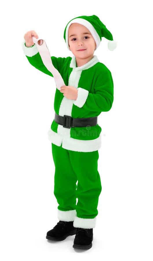 Weinig groene Santa Claus-lege de wenslijst van de jongensholding stock foto