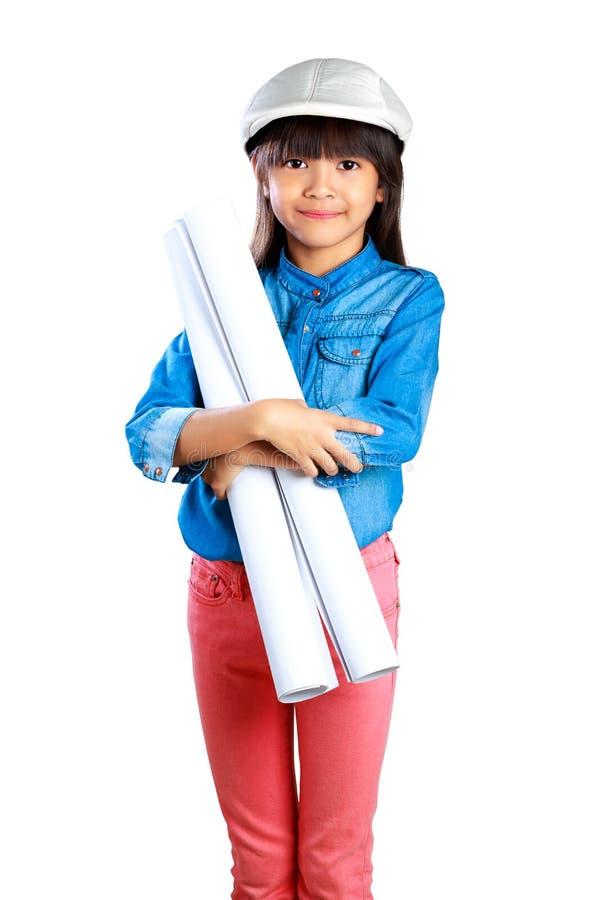 Weinig Ingenieur, Meisje in de bouwhelm met p stock foto's