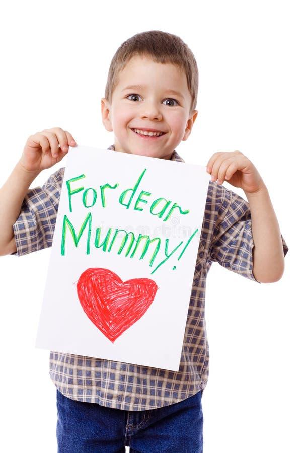 Weinig jongen die een tekening voor mum houdt royalty-vrije stock afbeeldingen