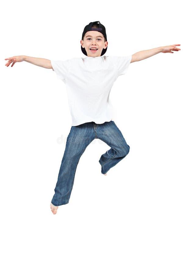 Weinig jongen die op geïsoleerdn springt royalty-vrije stock foto