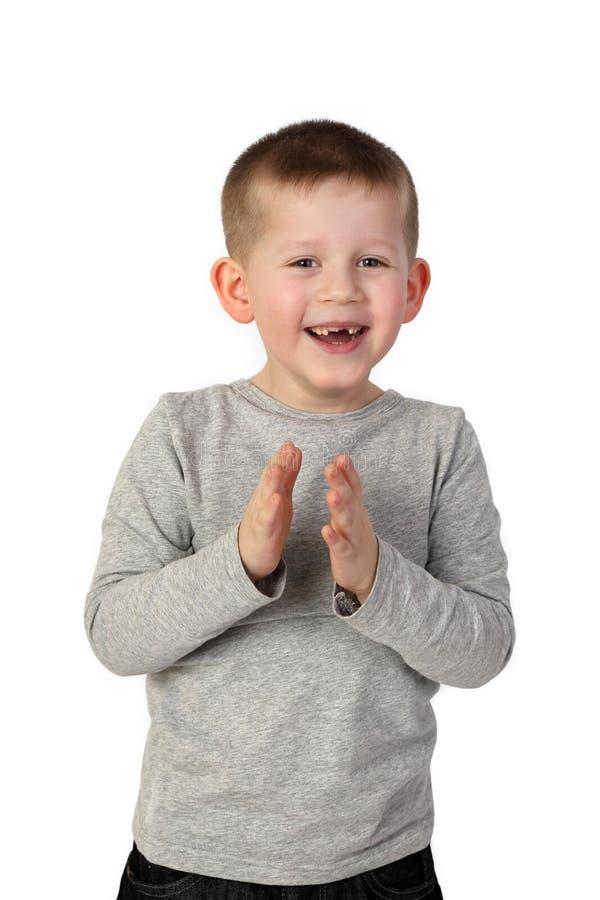 Weinig jongen die vreugdevol slaan stock foto's