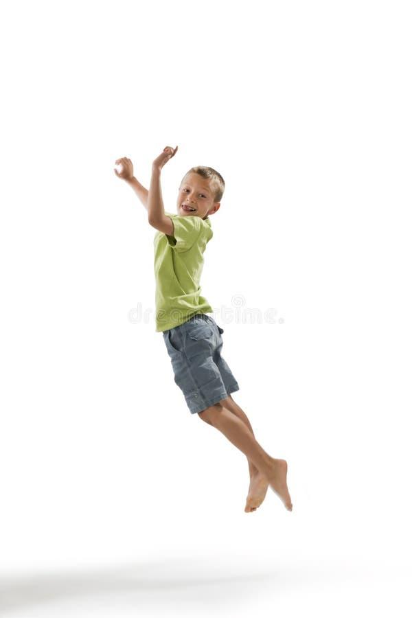 Weinig jongen het springen stock afbeeldingen