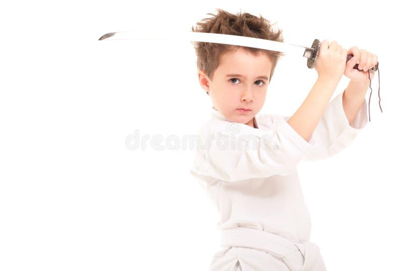 Weinig jongen in kimono met zwaard royalty-vrije stock afbeelding