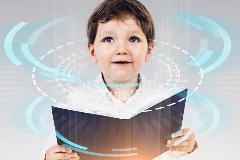 Weinig jongen met boek, digitale onderwijsinterface royalty-vrije stock foto