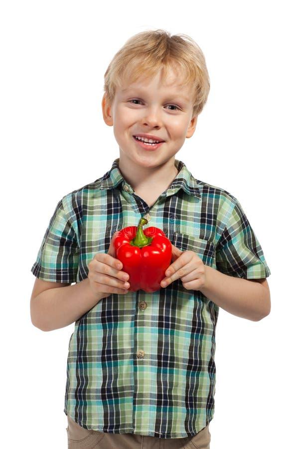 Weinig jongen met paprika stock afbeelding