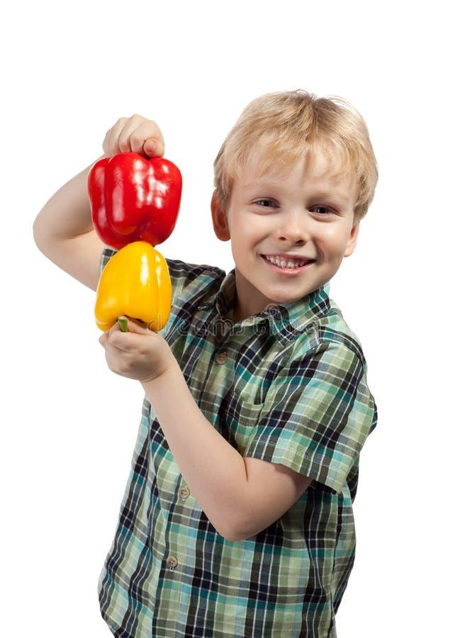 Weinig jongen met paprika royalty-vrije stock afbeeldingen
