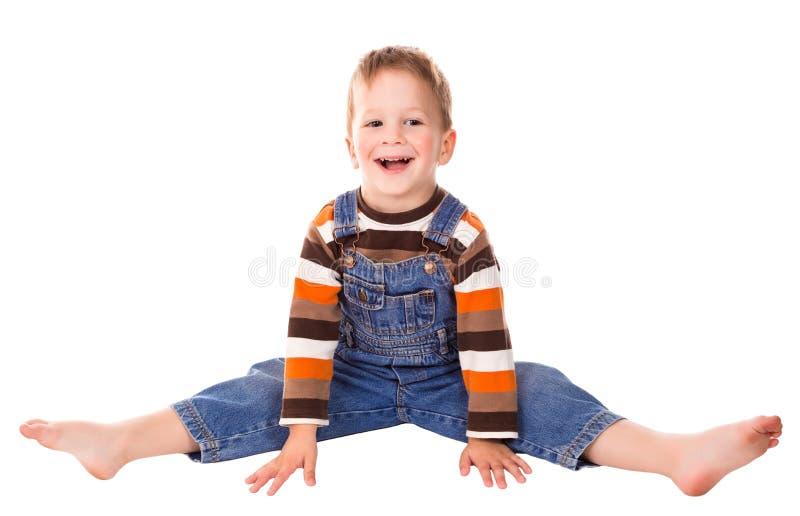 Weinig jongen op de vloer stock afbeeldingen