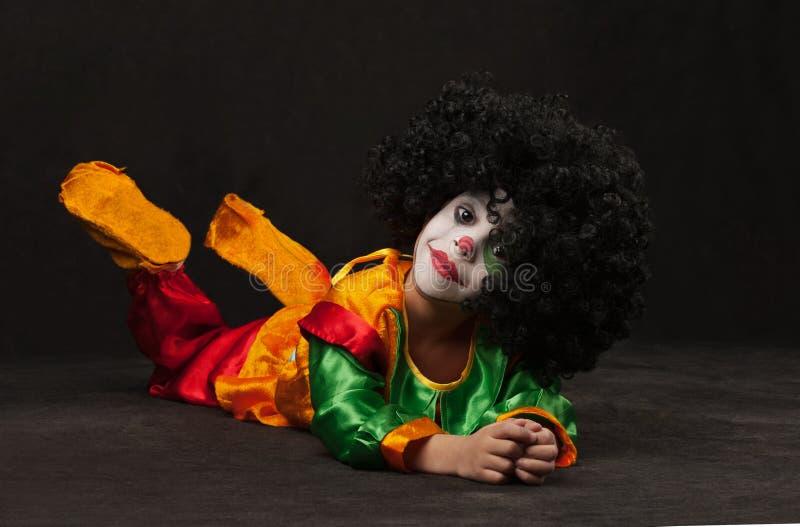 Weinig jongen, samenstelling van de clown royalty-vrije stock afbeeldingen