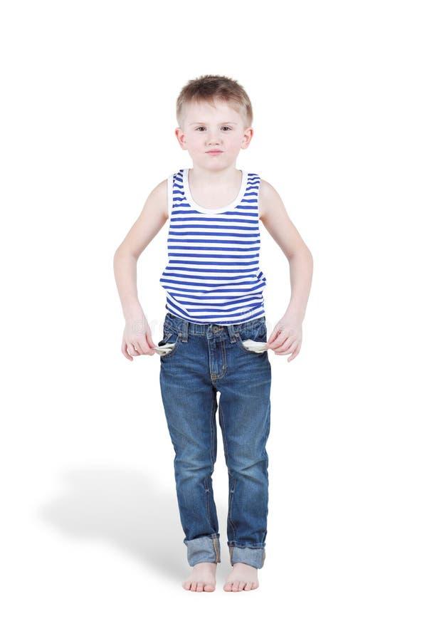 Weinig jongen toont gebleken lege zakken royalty-vrije stock afbeelding
